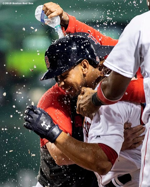 BOSTON, MA - JUNE 24: Marco Hernandez #40 of the Boston Red Sox reacts with teammates after hitting the game winning walk-off infield single during the ninth inning of a game against the Chicago White Sox on June 24, 2019 at Fenway Park in Boston, Massachusetts. (Photo by Billie Weiss/Boston Red Sox/Getty Images) *** Local Caption *** Marco Hernandez