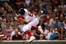 BOSTON, MA - JUNE 24: Mookie Betts #50 of the Boston Red Sox evades getting hit with a pitch during the eighth inning of a game against the Chicago White Sox on June 24, 2019 at Fenway Park in Boston, Massachusetts. (Photo by Billie Weiss/Boston Red Sox/Getty Images) *** Local Caption *** Mookie Betts