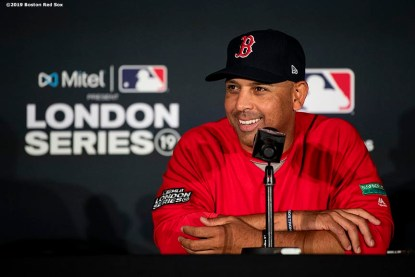 LONDON, ENGLAND - JUNE 28 : Manager Alex Cora of the Boston Red Sox addresses the media in a press conference during a team workout ahead of the 2019 Major League Baseball London Series on June 28, 2019 at West Ham London Stadium in London, England. (Photo by Billie Weiss/Boston Red Sox/Getty Images) *** Local Caption *** Alex Cora