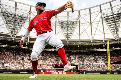 LONDON, ENGLAND - JUNE 30: Xander Bogaerts #2 of the Boston Red Sox warms up before game two of the 2019 Major League Baseball London Series against the New York Yankees on June 30, 2019 at West Ham London Stadium in London, England. (Photo by Billie Weiss/Boston Red Sox/Getty Images) *** Local Caption *** Xander Bogaerts