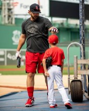 BOSTON, MA - JULY 16: Mitch Moreland #18 of the Boston Red Sox reacts with his son Crue before a game against the Toronto Blue Jays on July 16, 2019 at Fenway Park in Boston, Massachusetts. (Photo by Billie Weiss/Boston Red Sox/Getty Images) *** Local Caption *** Mitch Moreland