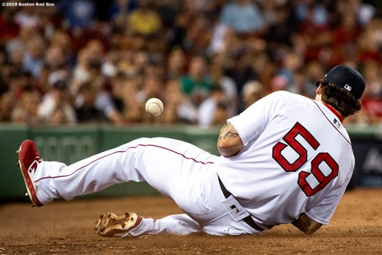 BOSTON, MA - JULY 16: Sam Travis #59 of the Boston Red Sox bobbles the ball as he attempts to catch a foul ball during the eighth inning of a game against the Toronto Blue Jays on July 16, 2019 at Fenway Park in Boston, Massachusetts. (Photo by Billie Weiss/Boston Red Sox/Getty Images) *** Local Caption *** Sam Travis