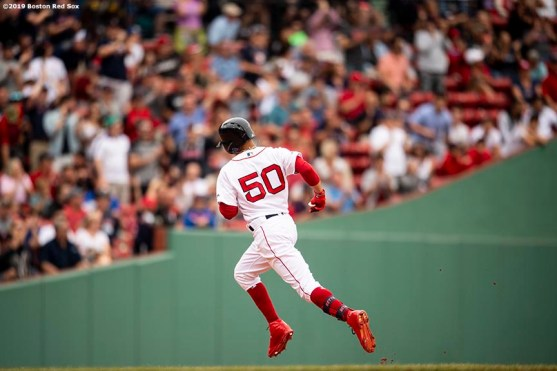 BOSTON, MA - JULY 18: Mookie Betts #50 of the Boston Red Sox rounds the bases after hitting a solo home run during the seventh inning of a game against the Toronto Blue Jays on July 18, 2019 at Fenway Park in Boston, Massachusetts. (Photo by Billie Weiss/Boston Red Sox/Getty Images) *** Local Caption *** Mookie Betts