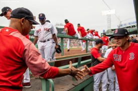 BOSTON, MA - JULY 18: Manager Alex Cora shakes hands with hitting coach Tim Hyers of the Boston Red Sox after a victory against the Toronto Blue Jays on July 18, 2019 at Fenway Park in Boston, Massachusetts. (Photo by Billie Weiss/Boston Red Sox/Getty Images) *** Local Caption *** Alex Cora; Tim Hyers