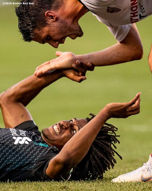 BOSTON, MA - JULY 21: Yasser Larouci #65 of Liverpool argues with Sebastien Mathieu Corchia #2 of Sevilla F.C. during the second half of a pre-season friendly match on July 21, 2019 at Fenway Park in Boston, Massachusetts. (Photo by Billie Weiss/Boston Red Sox/Getty Images) *** Local Caption *** Yasser Larouci; Sebastien Mathieu Corchia