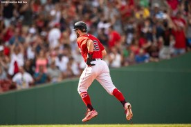 BOSTON, MA - JULY 27: Andrew Benintendi #16 of the Boston Red Sox rounds the bases after hitting a ground rule double that was reviewed and overturned to a solo home run during the second inning of a game against the New York Yankees on July 27, 2019 at Fenway Park in Boston, Massachusetts. (Photo by Billie Weiss/Boston Red Sox/Getty Images) *** Local Caption *** Andrew Benintendi
