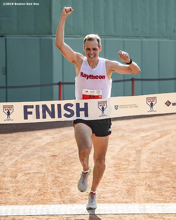 July 27, 2019 , Boston, MA: The first place runner finishes during the 2019 Run to Home Base presented by New Balance at Fenway Park in Boston, Massachusetts Saturday, July 27, 2019. (Photo by Billie Weiss/Home Base)