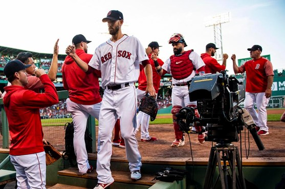 BOSTON, MA - AUGUST 5: Rick Porcello #22 of the Boston Red Sox high fives teammates before a game against the Kansas City Royals on August 5, 2019 at Fenway Park in Boston, Massachusetts. (Photo by Billie Weiss/Boston Red Sox/Getty Images) *** Local Caption *** Rick Porcello