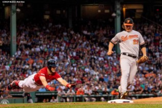 BOSTON, MA - AUGUST 17: Asher Wojciechowski #29 of the Baltimore Orioles covers the base as Andrew Benintendi #16 of the Boston Red Sox dives during the first inning of a game on August 17, 2019 at Fenway Park in Boston, Massachusetts. (Photo by Billie Weiss/Boston Red Sox/Getty Images) *** Local Caption *** Asher Wojciechowski; Andrew Benintendi