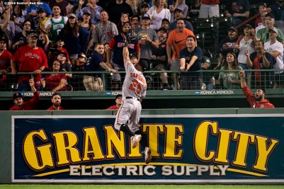 BOSTON, MA - AUGUST 17: Anthony Santander #25 of the Baltimore Orioles attempts to catch a home run ball hit by Brock Holt #12 of the Boston Red Sox as members of the bullpen react during the fifth inning of a game on August 17, 2019 at Fenway Park in Boston, Massachusetts. (Photo by Billie Weiss/Boston Red Sox/Getty Images) *** Local Caption *** Anthony Santander