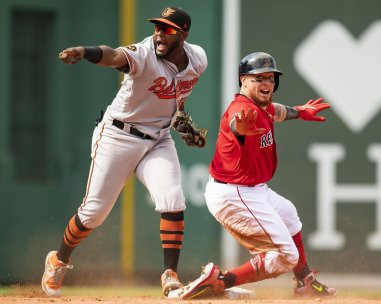 BOSTON, MA - AUGUST 18: Christian Vazquez #7 of the Boston Red Sox reacts after sliding in safely after hitting an RBI double as Hanser Alberto #57 of the Baltimore Orioles reacts during the sixth inning of a game on August 18, 2019 at Fenway Park in Boston, Massachusetts. (Photo by Billie Weiss/Boston Red Sox/Getty Images) *** Local Caption *** Christian Vazquez; Hanser Alberto