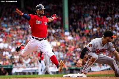 BOSTON, MA - AUGUST 18: Xander Bogaerts #2 of the Boston Red Sox reacts as he reaches first base safely after hitting an RBI infield single to beat the catch of Chris Davis #19 of the Baltimore Orioles during the sixth inning of a game on August 18, 2019 at Fenway Park in Boston, Massachusetts. (Photo by Billie Weiss/Boston Red Sox/Getty Images) *** Local Caption *** Xander Bogaerts