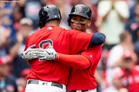 BOSTON, MA - AUGUST 18: Rafael Devers #11 of the Boston Red Sox hugs Xander Bogaerts #2 after hitting a two run home run to record his 100th and 101st RBI of the season during the seventh inning of a game against the Baltimore Orioles on August 18, 2019 at Fenway Park in Boston, Massachusetts. (Photo by Billie Weiss/Boston Red Sox/Getty Images) *** Local Caption *** Rafael Devers; Xander Bogaerts