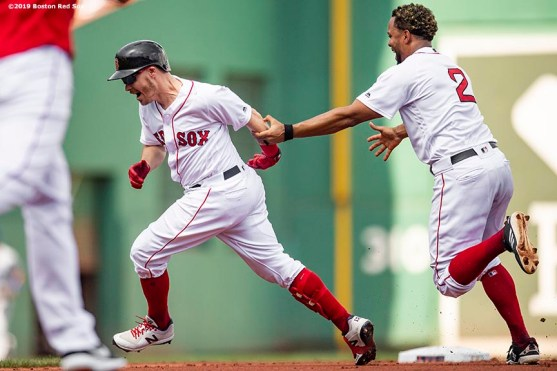 BOSTON, MA - AUGUST 22: Brock Holt #12 of the Boston Red Sox reacts after hitting a game winning walk-off RBI single during the tenth inning of a game against the Kansas City Royals on August 22, 2019 at Fenway Park in Boston, Massachusetts. The game is the completion of the game that was suspended due to weather on August 7 in the top of the 10th inning with a tied score of 4-4. (Photo by Billie Weiss/Boston Red Sox/Getty Images) *** Local Caption *** Brock Holt