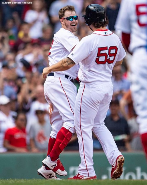 BOSTON, MA - AUGUST 22: Brock Holt #12 of the Boston Red Sox reacts with Sam Travis #59 after hitting a game winning walk-off RBI single during the tenth inning of a game against the Kansas City Royals on August 22, 2019 at Fenway Park in Boston, Massachusetts. The game is the completion of the game that was suspended due to weather on August 7 in the top of the 10th inning with a tied score of 4-4. (Photo by Billie Weiss/Boston Red Sox/Getty Images) *** Local Caption *** Brock Holt; Sam Travis