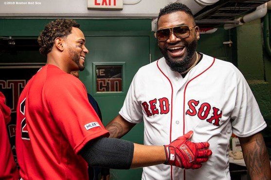 BOSTON, MA - SEPTEMBER 9: Former designated hitter David Ortiz #34 of the Boston Red Sox greets Xander Bogaerts #2 of the Boston Red Sox before throwing out a ceremonial first pitch as he returns to Fenway Park before a game against the New York Yankees on September 9, 2019 at Fenway Park in Boston, Massachusetts. (Photo by Billie Weiss/Boston Red Sox/Getty Images) *** Local Caption *** David Ortiz; Xander Bogaerts