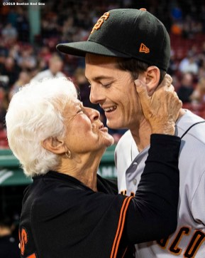 BOSTON, MA - SEPTEMBER 17: Mike Yastrzemski #5 of the San Francisco Giants is greeted by a family member during the inning of a game against the Boston Red Sox on September 17, 2019 at Fenway Park in Boston, Massachusetts. (Photo by Billie Weiss/Boston Red Sox/Getty Images) *** Local Caption *** Mike Yastrzemski