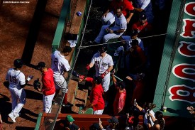 BOSTON, MA - SEPTEMBER 28: Xander Bogaerts #2 of the Boston Red Sox high fives teammates after hitting a home run during the first inning of a game against the Baltimore Orioles on September 28, 2019 at Fenway Park in Boston, Massachusetts. (Photo by Billie Weiss/Boston Red Sox/Getty Images) *** Local Caption *** Xander Bogaerts