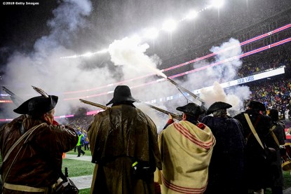 FOXBOROUGH, MA - NOVEMBER 24: Members of the End Zone Militia fire guns during the second quarter of a game between the New England Patriots and the Dallas Cowboys at Gillette Stadium on November 24, 2019 in Foxborough, Massachusetts. (Photo by Billie Weiss/Getty Images) *** Local Caption ***