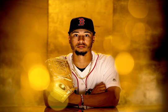 FT. MYERS, FL - FEBRUARY 27: Mookie Betts #50 of the Boston Red Sox poses for a portrait with the Gold Glove award during a team workout on February 27, 2019 at JetBlue Park at Fenway South in Fort Myers, Florida. (Photo by Billie Weiss/Boston Red Sox/Getty Images) *** Local Caption *** Mookie Betts