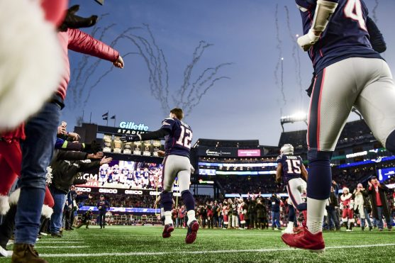 FOXBOROUGH, MA - DECEMBER 21:Tom Brady #12 of the New England Patriots runs onto the field before a game against the Buffalo Bills at Gillette Stadium on December 21, 2019 in Foxborough, Massachusetts. (Photo by Billie Weiss/Getty Images) *** Local Caption *** Tom Brady