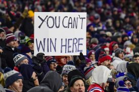 FOXBOROUGH, MA - DECEMBER 21: A fan displays a sign during a game between the New England Patriots and the Buffalo Bills at Gillette Stadium on December 21, 2019 in Foxborough, Massachusetts. (Photo by Billie Weiss/Getty Images) *** Local Caption ***