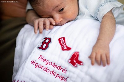 WESTON, FL - DECEMBER 4: Christian Vazquez #7 of the Boston Red Sox holds his newborn son Diego at his home on December 4, 2019 in Weston, Florida. (Photo by Billie Weiss/Boston Red Sox/Getty Images) *** Local Caption *** Christian Vazquez