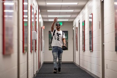 FT. MYERS, FL - FEBRUARY 15: Xander Bogaerts #2 of the Boston Red Sox waves as he arrives during a team workout on February 15, 2020 at JetBlue Park at Fenway South in Fort Myers, Florida. (Photo by Billie Weiss/Boston Red Sox/Getty Images) *** Local Caption *** Xander Bogaerts