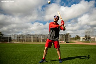 FT. MYERS, FL - FEBRUARY 16: Andrew Benintendi #16 of the Boston Red Sox hits a ball during a team workout on February 16, 2020 at jetBlue Park at Fenway South in Fort Myers, Florida. (Photo by Billie Weiss/Boston Red Sox/Getty Images) *** Local Caption *** Andrew Benintendi