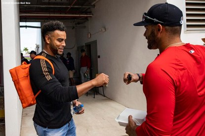 FT. MYERS, FL - FEBRUARY 28: J.D. Martinez #28 of the Boston Red Sox greets Nelson Cruz #23 of the Minnesota Twins as he arrives to CenturyLink Sports Complex for a Grapefruit League game on February 28, 2020 in Fort Myers, Florida. (Photo by Billie Weiss/Boston Red Sox/Getty Images) *** Local Caption *** J.D. Martinez; Nelson Cruz