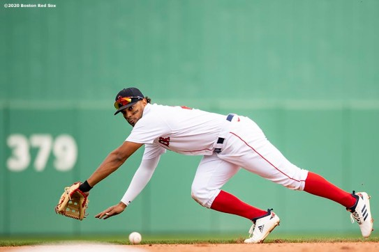FT. MYERS, FL - MARCH 8: Xander Bogaerts #2 of the Boston Red Sox makes a diving stop during the fourth inning of a Grapefruit League game against the Minnesota Twins on March 8, 2020 at jetBlue Park at Fenway South in Fort Myers, Florida. (Photo by Billie Weiss/Boston Red Sox/Getty Images) *** Local Caption *** Xander Bogaerts