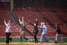 BOSTON, MA - APRIL 9: Medical professionals from Beth Israel Deaconess Medical Center react as they cross home plate after running a lap around the bases as they are welcomed onto the empty field at Fenway Park in recognition of their work during the coronavirus pandemic on April 9, 2020 at Fenway Park in Boston, Massachusetts. The welcoming was filmed for the 'Some Good News With John Krasinski' YouTube series. (Photo by Billie Weiss/Boston Red Sox/Getty Images) *** Local Caption ***