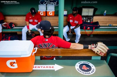 BOSTON, MA - JULY 21: Andrew Benintendi #16 of the Boston Red Sox sits in the dugout before a scrimmage game against the Toronto Blue Jays before the start of the 2020 Major League Baseball season on July 21, 2020 at Fenway Park in Boston, Massachusetts. The season was delayed due to the coronavirus pandemic. (Photo by Billie Weiss/Boston Red Sox/Getty Images) *** Local Caption *** Andrew Benintendi