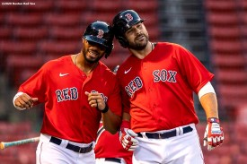 BOSTON, MA - JULY 21: Mitch Moreland #18 of the Boston Red Sox reacts with Xander Bogaerts #2 after hitting a three run home run during the first inning of an exhibition game against the Toronto Blue Jays before the start of the 2020 Major League Baseball season on July 21, 2020 at Fenway Park in Boston, Massachusetts. The season was delayed due to the coronavirus pandemic. (Photo by Billie Weiss/Boston Red Sox/Getty Images) *** Local Caption *** Mitch Moreland; Xander Bogaerts