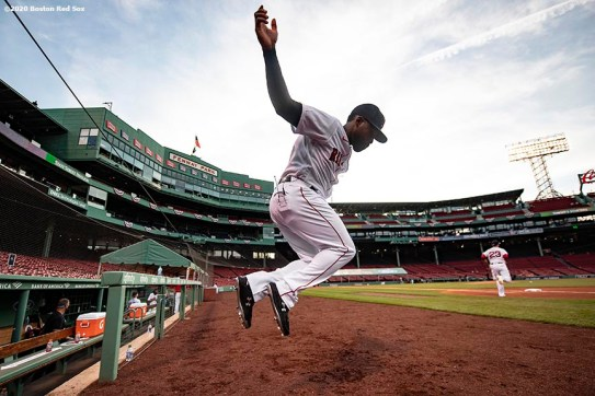 BOSTON, MA - JULY 24: Jackie Bradley Jr. #19 of the Boston Red Sox leaps out of the dugout during the Opening Day game against the Baltimore Orioles on July 24, 2020 at Fenway Park in Boston, Massachusetts. The 2020 season had been postponed since March due to the COVID-19 pandemic. (Photo by Billie Weiss/Boston Red Sox/Getty Images) *** Local Caption *** Jackie Bradley Jr.