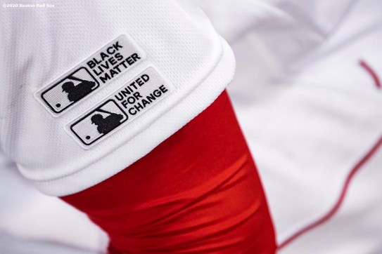 BOSTON, MA - JULY 24: Major League Baseball Black Lives Matter and United For Change patches are shown on a jersey during the Opening Day game between the Boston Red Sox and the Baltimore Orioles on July 24, 2020 at Fenway Park in Boston, Massachusetts. The 2020 season had been postponed since March due to the COVID-19 pandemic. (Photo by Billie Weiss/Boston Red Sox/Getty Images) *** Local Caption ***