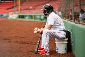 BOSTON, MA - JULY 25: Bat boy Chris Cundiff of the Boston Red Sox wears a mask as he looks on during the third inning of a game against the Baltimore Orioles on July 25, 2020 at Fenway Park in Boston, Massachusetts. The Major League Baseball season was delayed due to the coronavirus pandemic. (Photo by Billie Weiss/Boston Red Sox/Getty Images) *** Local Caption *** Chris Cundiff