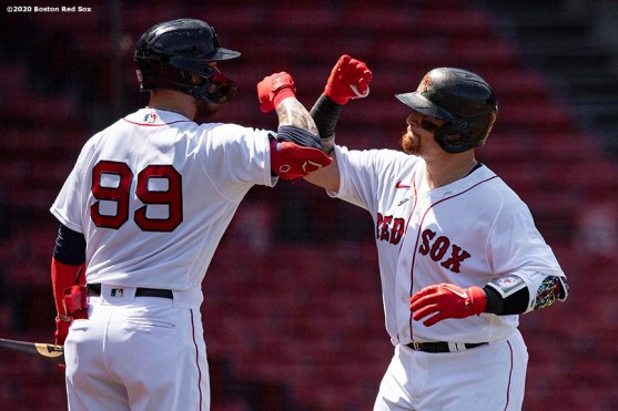 BOSTON, MA - JULY 26: Christian Vazquez #7 of the Boston Red Sox reacts with Alex Verdugo #99 after hitting a solo home run during second the inning of a game against the Baltimore Orioles on July 26, 2020 at Fenway Park in Boston, Massachusetts. The 2020 season had been postponed since March due to the COVID-19 pandemic. (Photo by Billie Weiss/Boston Red Sox/Getty Images) *** Local Caption *** Christian Vazquez; Alex Verdugo
