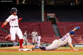 BOSTON, MA - JULY 27: Andrew Benintendi #16 of the Boston Red Sox beats out a bunt as Pete Alonso #20 of the New York Mets reaches for the ball during the first inning of a game on July 27, 2020 at Fenway Park in Boston, Massachusetts. The 2020 season had been postponed since March due to the COVID-19 pandemic. (Photo by Billie Weiss/Boston Red Sox/Getty Images) *** Local Caption *** Andrew Benintendi; Pete Alonso
