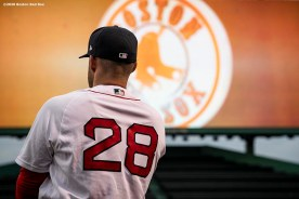 BOSTON, MA - AUGUST 7: J.D. Martinez #28 of the Boston Red Sox warms up before a game against the Toronto Blue Jays on August 7, 2020 at Fenway Park in Boston, Massachusetts. The 2020 season had been postponed since March due to the COVID-19 pandemic. (Photo by Billie Weiss/Boston Red Sox/Getty Images) *** Local Caption *** J.D. Martinez
