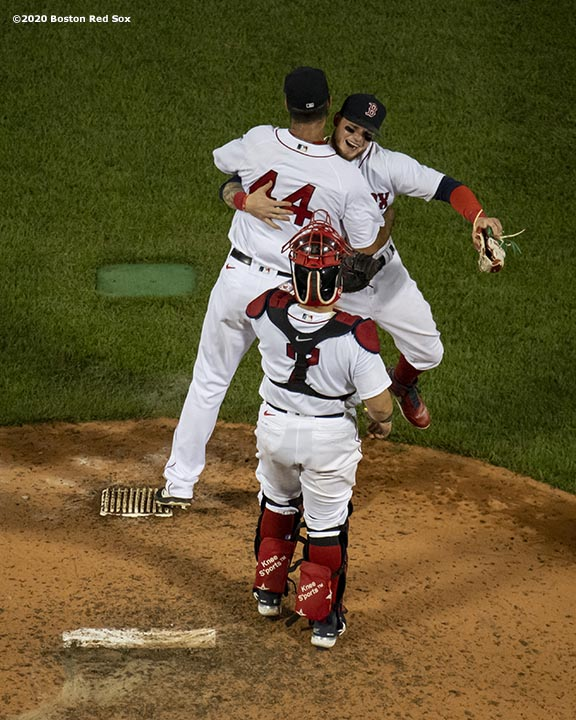 BOSTON, MA - AUGUST 7: Alex Verdugo #99 of the Boston Red Sox hugs Brandon Workman #44 after a game against the Toronto Blue Jays on August 7, 2020 at Fenway Park in Boston, Massachusetts. The 2020 season had been postponed since March due to the COVID-19 pandemic. (Photo by Billie Weiss/Boston Red Sox/Getty Images) *** Local Caption *** Alex Verdugo; Brandon Workman