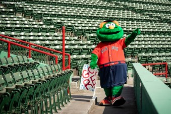 BOSTON, MA - AUGUST 9: Boston Red Sox mascot Wally the Green Monster reacts during a game against the Toronto Blue Jays on August 9, 2020 at Fenway Park in Boston, Massachusetts. It was his second home run of the day. The 2020 season had been postponed since March due to the COVID-19 pandemic. (Photo by Billie Weiss/Boston Red Sox/Getty Images) *** Local Caption ***