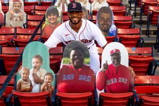 BOSTON, MA - AUGUST 10: Xander Bogaerts #2 of the Boston Red Sox poses for a photograph with cardboard cutout members of his family before a game against the Tampa Bay Rays on August 10, 2020 at Fenway Park in Boston, Massachusetts. The 2020 season had been postponed since March due to the COVID-19 pandemic. (Photo by Billie Weiss/Boston Red Sox/Getty Images) *** Local Caption *** Xander Bogaerts