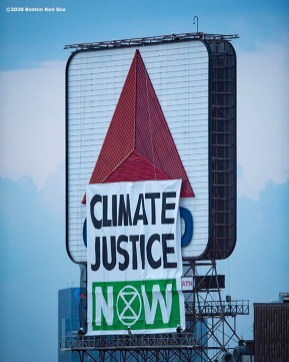 BOSTON, MA - AUGUST 10: A sign reading Climate Justice Now is placed in protest in front of the Citgo Sign in Kenmore Square during a game between the Boston Red Sox and the Tampa Bay Rays on August 10, 2020 at Fenway Park in Boston, Massachusetts. The 2020 season had been postponed since March due to the COVID-19 pandemic. (Photo by Billie Weiss/Boston Red Sox/Getty Images) *** Local Caption ***