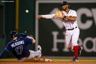 BOSTON, MA - AUGUST 10: Xander Bogaerts #2 of the Boston Red Sox turns a double play over Austin Meadows #17 of the Tampa Bay Rays during the ninth inning of a game on August 10, 2020 at Fenway Park in Boston, Massachusetts. The 2020 season had been postponed since March due to the COVID-19 pandemic. (Photo by Billie Weiss/Boston Red Sox/Getty Images) *** Local Caption *** Xander Bogaerts; Austin Meadows