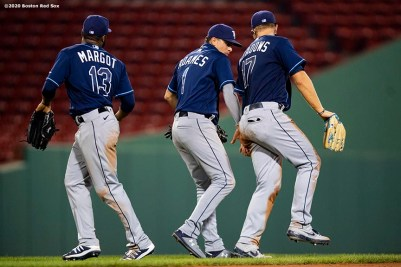 BOSTON, MA - AUGUST 10: Manuel Margot #13, Willy Adames #1 and Austin Meadows #17 of the Tampa Bay Rays celebrate a victory against the Boston Red Sox on August 10, 2020 at Fenway Park in Boston, Massachusetts. The 2020 season had been postponed since March due to the COVID-19 pandemic. (Photo by Billie Weiss/Boston Red Sox/Getty Images) *** Local Caption *** Manuel Margot; Willy Adames; Austin Meadows