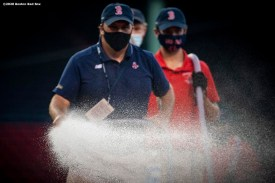 BOSTON, MA - AUGUST 11: Members of the Grounds Crew work before a game between the Boston Red Sox and the Tampa Bay Rays on August 11, 2020 at Fenway Park in Boston, Massachusetts. The 2020 season had been postponed since March due to the COVID-19 pandemic. (Photo by Billie Weiss/Boston Red Sox/Getty Images) *** Local Caption ***