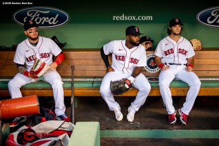 BOSTON, MA - AUGUST 11: Alex Verdugo #99, Jackie Bradley Jr. #18, and Andrew Benintendi #16 of the Boston Red Sox sit in the dugout before a game against the Tampa Bay Rays on August 11, 2020 at Fenway Park in Boston, Massachusetts. The 2020 season had been postponed since March due to the COVID-19 pandemic. (Photo by Billie Weiss/Boston Red Sox/Getty Images) *** Local Caption *** Alex Verdugo; Jackie Bradley Jr.; Andrew Benintendi