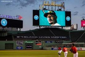 BOSTON, MA - AUGUST 28: The image of Mookie Betts #50 of the Los Angeles Dodgers is displayed as a video in recognition of Jackie Robinson Day is played during a pre-game ceremony before a game between the Boston Red Sox and the Washington Nationals on August 28, 2020 at Fenway Park in Boston, Massachusetts. The 2020 season had been postponed since March due to the COVID-19 pandemic. (Photo by Billie Weiss/Boston Red Sox/Getty Images) *** Local Caption *** Mookie Betts