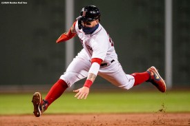 BOSTON, MA - AUGUST 31: Alex Verdugo #99 of the Boston Red Sox slides during the third inning of a game against the Atlanta Braves on August 31, 2020 at Fenway Park in Boston, Massachusetts. The 2020 season had been postponed since March due to the COVID-19 pandemic. (Photo by Billie Weiss/Boston Red Sox/Getty Images) *** Local Caption *** Alex Verdugo